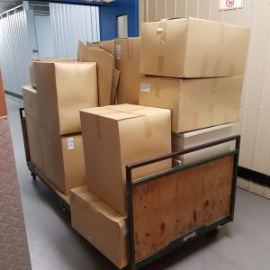 Moving boxes stacked on moving trolly